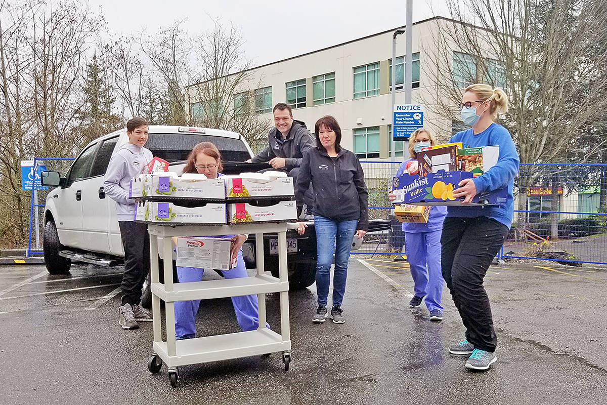 Staff at Langley Memorial Hospital unloaded a delivery of food from the Fraser Valley Volleyball Club for staff in the ER and ICU on Saturday, March 28th. (Dan Ferguson/Langley Advance Times)