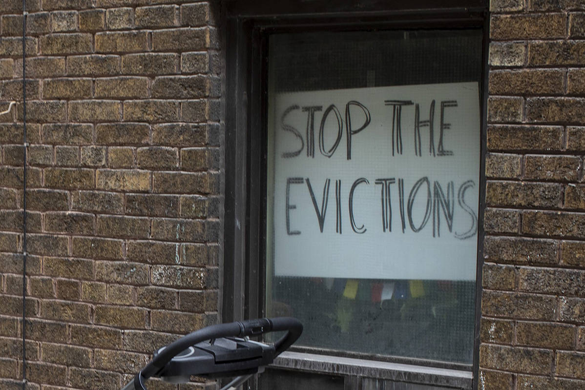 A sign hangs in the window of a west Toronto apartment on Thursday March 19, 2020. B.C. is one of multiple provinces that has put a moratorium on evictions amid COVID-19. THE CANADIAN PRESS/Chris Young