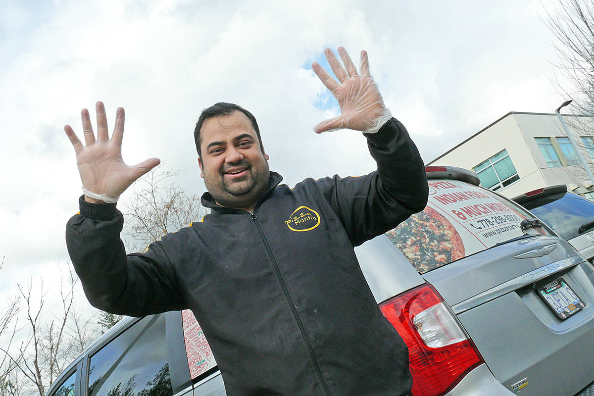 """Hiten Gupta, owner of Pizza Mantra, demonstrated his no-contact """"high 10"""" greeting. Gupta brought 112 pizzas to Langley Memorial Hospital on Sunday, March 29th (Dan Ferguson/Langley Advance Times)"""