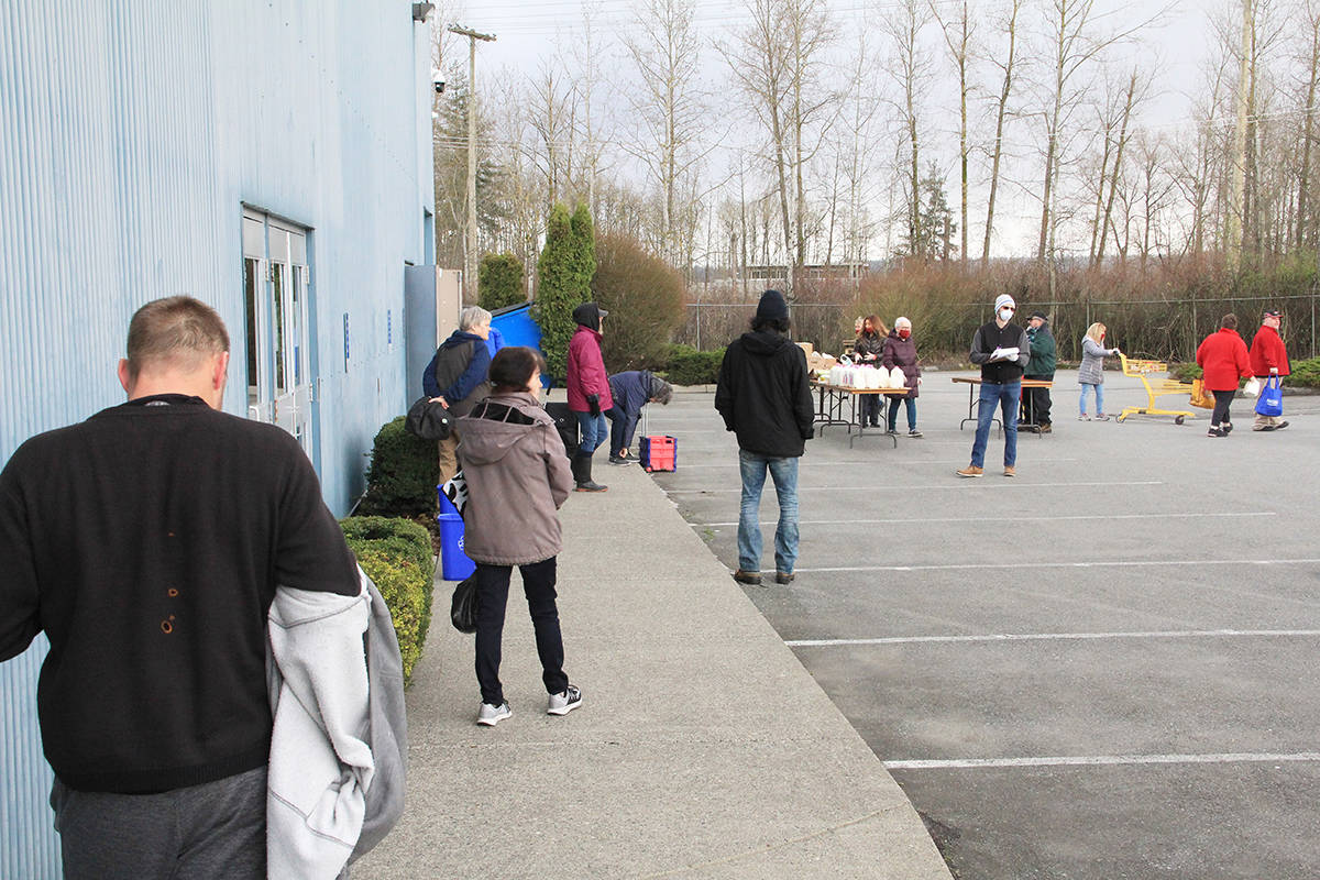 People line up to receive groceries outside the Fraser Valley Regional Food Bank in Cloverdale March 30. The Lower Mainland's newest food bank has seen a surge in need over the last couple of weeks. (Photo: Malin Jordan)