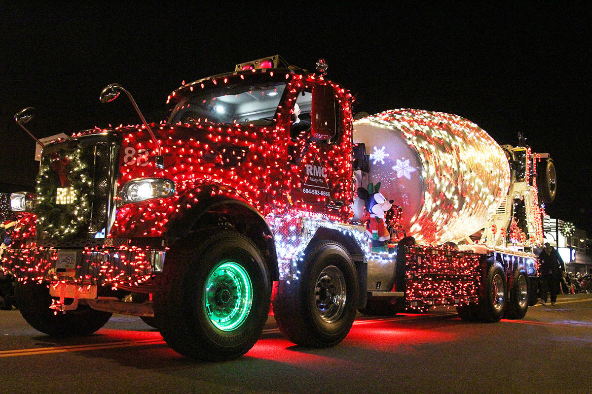 A Ready-Mix Concrete truck rolls through Cloverdale Dec. 1, 2019 in the 14th annual Surrey Santa Parade of Lights. Event organizer Paul Orazietti says the parade may be cancelled in 2020 because of skyrocketing traffic control an security costs. (Photo: Olivia Johnson)