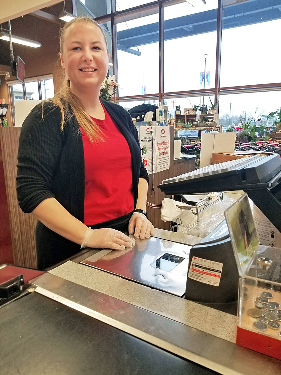 Aldergrove resident Shaylin Thulin is one of more than 60 employees still serving customers at the IGA Murrayville store, which is operating under strict precautions during the COVID-19 outbreak. (Dan Ferguson/Langley Advance Times)