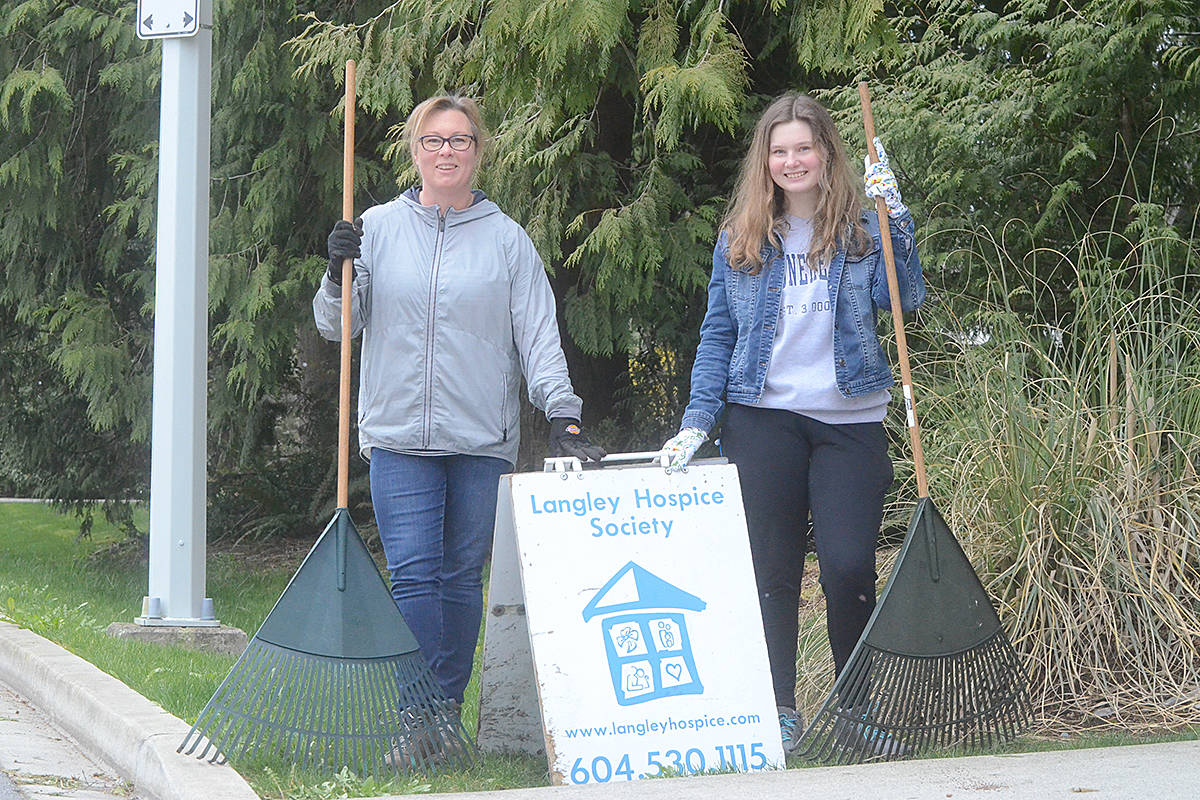 Shannon Todd Booth, left, and her daughter Hope Booth were helping out with yard work at the Langley Hospice Society's Supportive Program Centre on Thursday, April 2. (Matthew Claxton/Langley Advance Times)