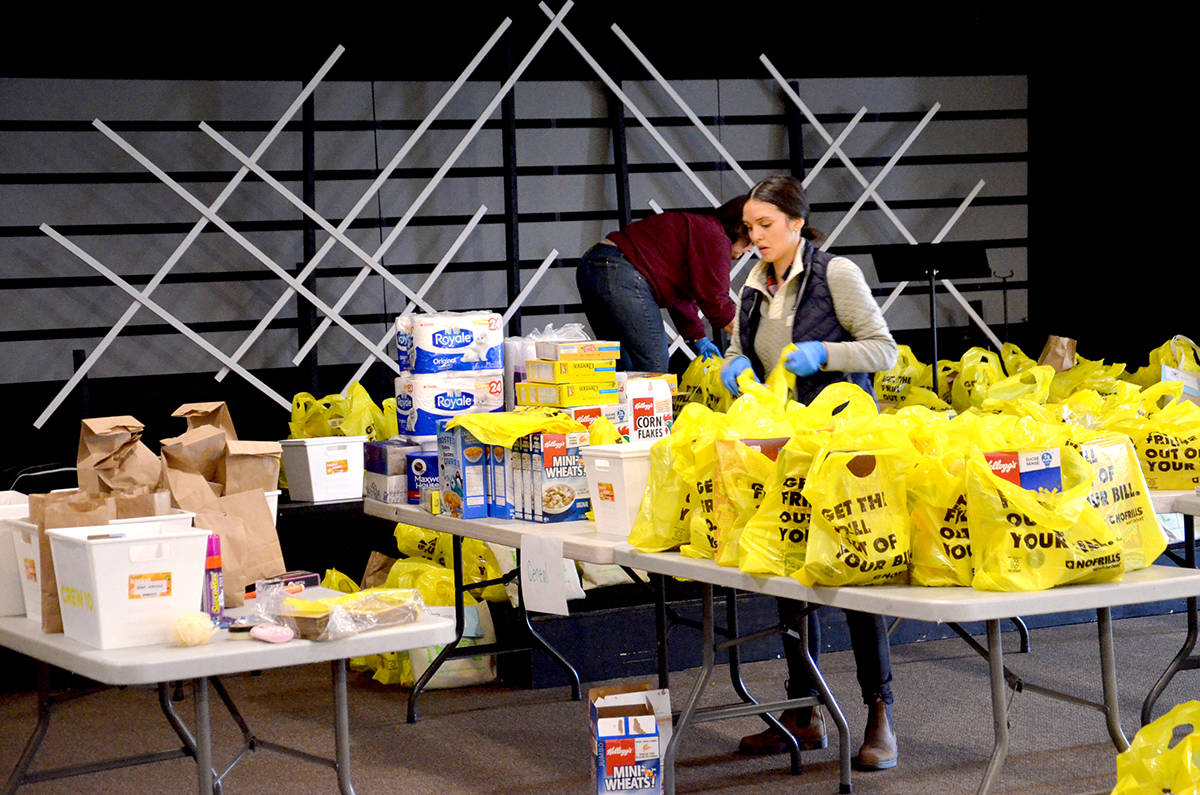Churches offer food hampers for low income families at Thursday pickup event