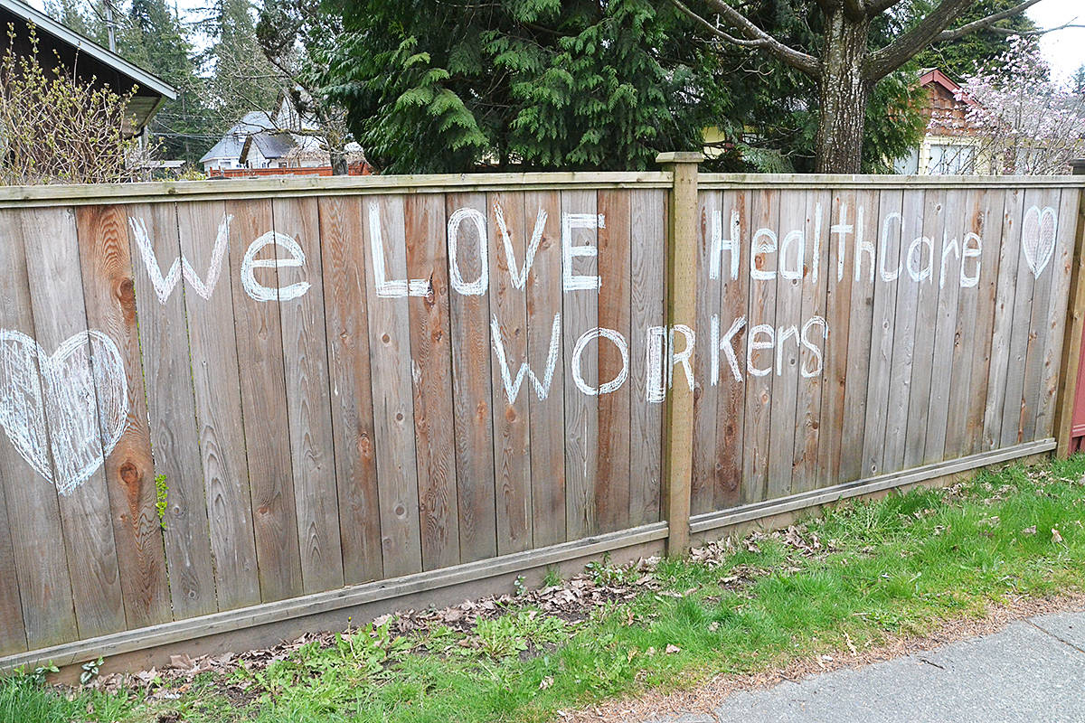 A fence in Brookswood bears a message of support for the health care workers on the front lines of the COVID-19 crisis. (Matthew Claxton/Langley Advance Times)
