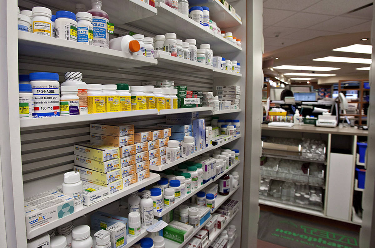 A shelf of drugs at a pharmacy in Quebec City on March 8, 2012. A new policy among pharmacists to restrict patients to a 30-day supply of their medications means some patients are having to pay dispensing fees two or three times over. (Jacques Boissinot/The Canadian Press)