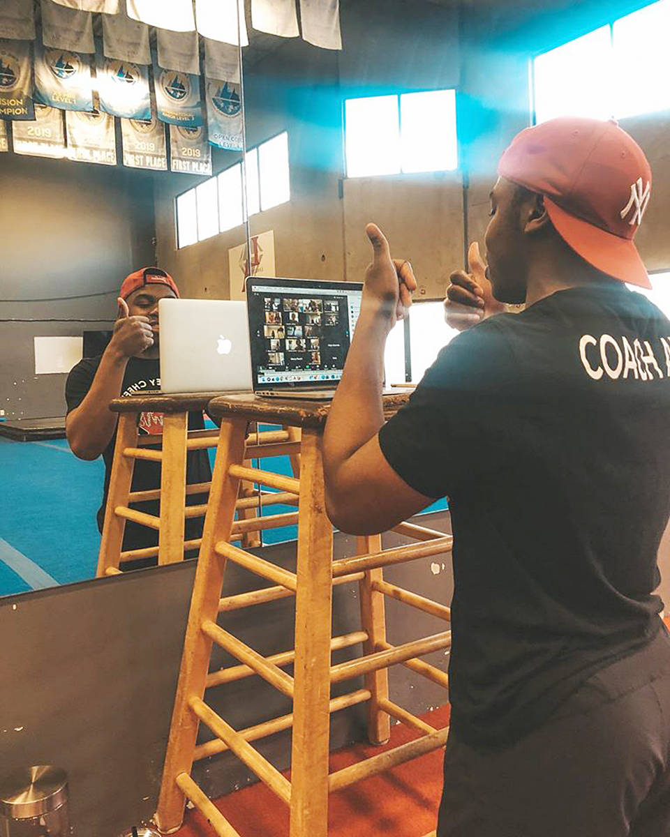 Langley Cheer Athletics Gym Coach Axel Obame puts athletes through their paces online. (Sam Farrell/special to Langley Advance Times)