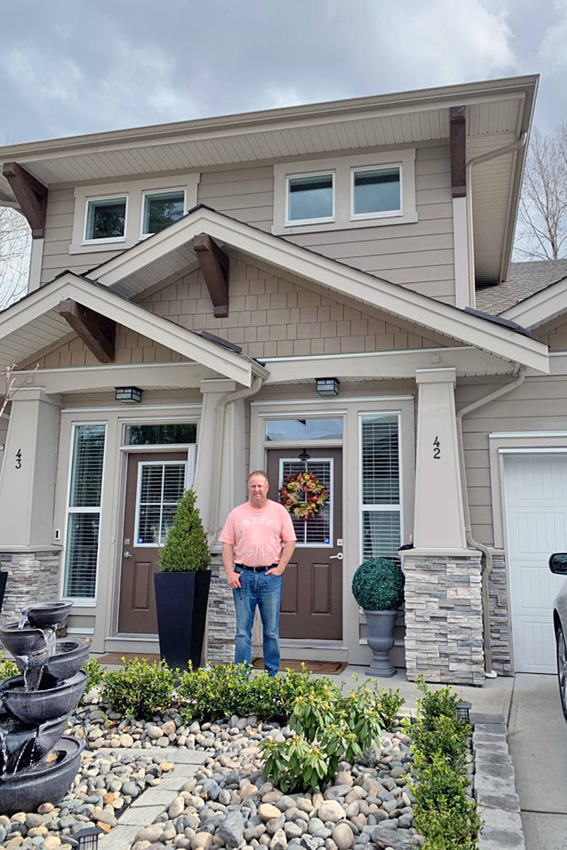 Rob Parker, strata council president at the Prestwick townhouse development, seen here outside his home on Saturday, March 4th, was told the insurance premium shared by all owners would triple. (Special to Langley Advance Times)