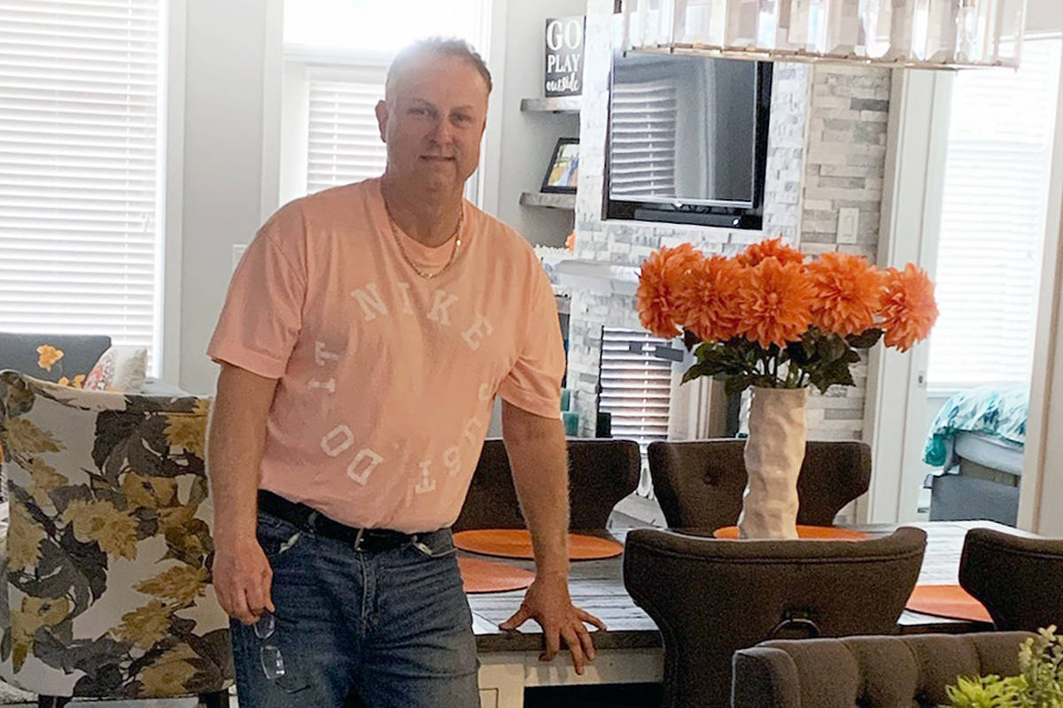 Rob Parker, strata council president at the Prestwick townhouse development, seen here in his home on Saturday, March 4th, was told the insurance premium shared by all owners would triple. (Special to Langley Advance Times)