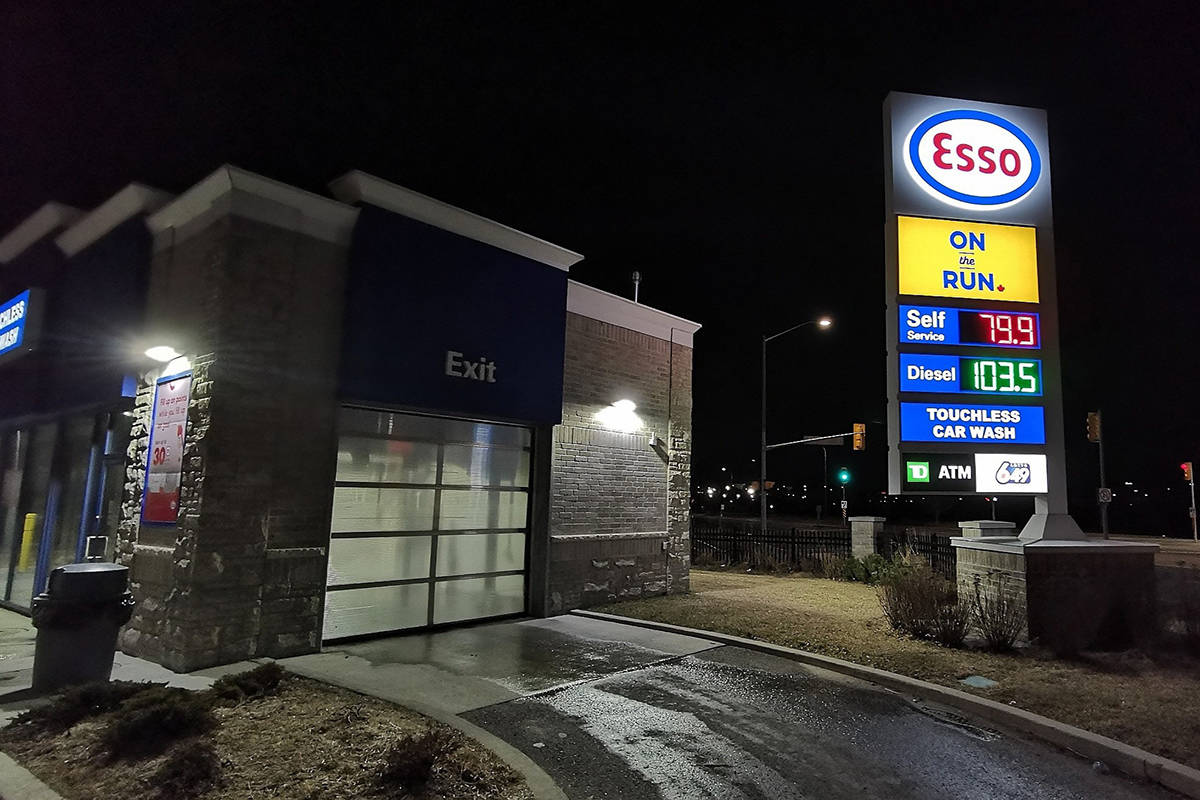 Gas prices are shown on a sign at an Esso station in Whitby, Ont., east of Toronto, on Wednesday, March 18, 2020. Parkland Fuel Corp. says it is cutting its 2020 capital spending budget by 52 per cent and cutting its executive salaries in response to the uncertain economic impact of the novel coronavirus.THE CANADIAN PRESS/ Doug Ives