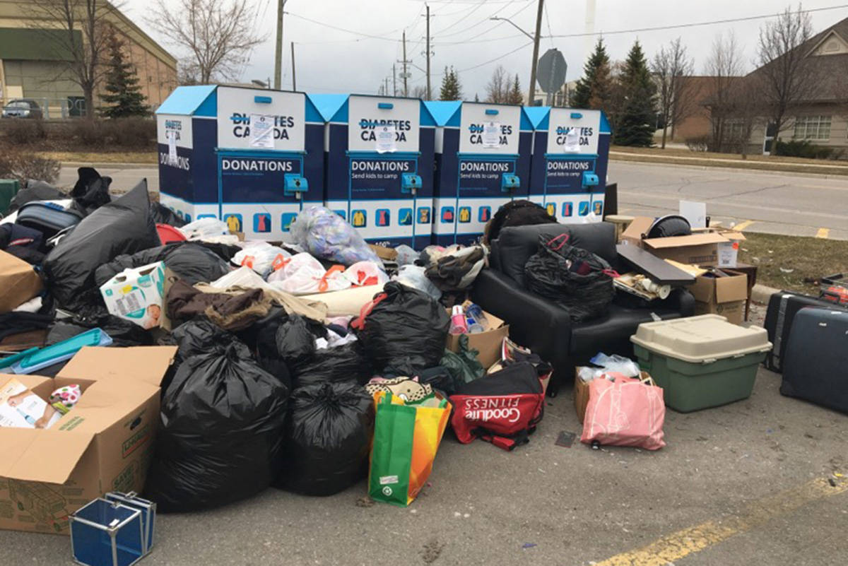 A photo posted to social media by Diabetes Canada on Monday, April 6, 2020, shows piles of donations and trash in front of bins. (Diabetes Canada)