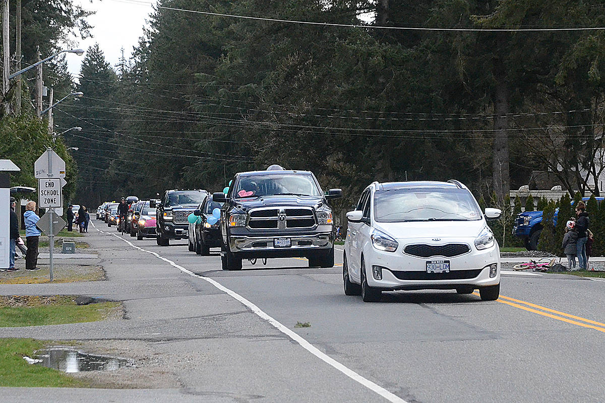 A parade of more than a dozen cars passed through Brookswood last week. (Matthew Claxton/Langley Advance Times)