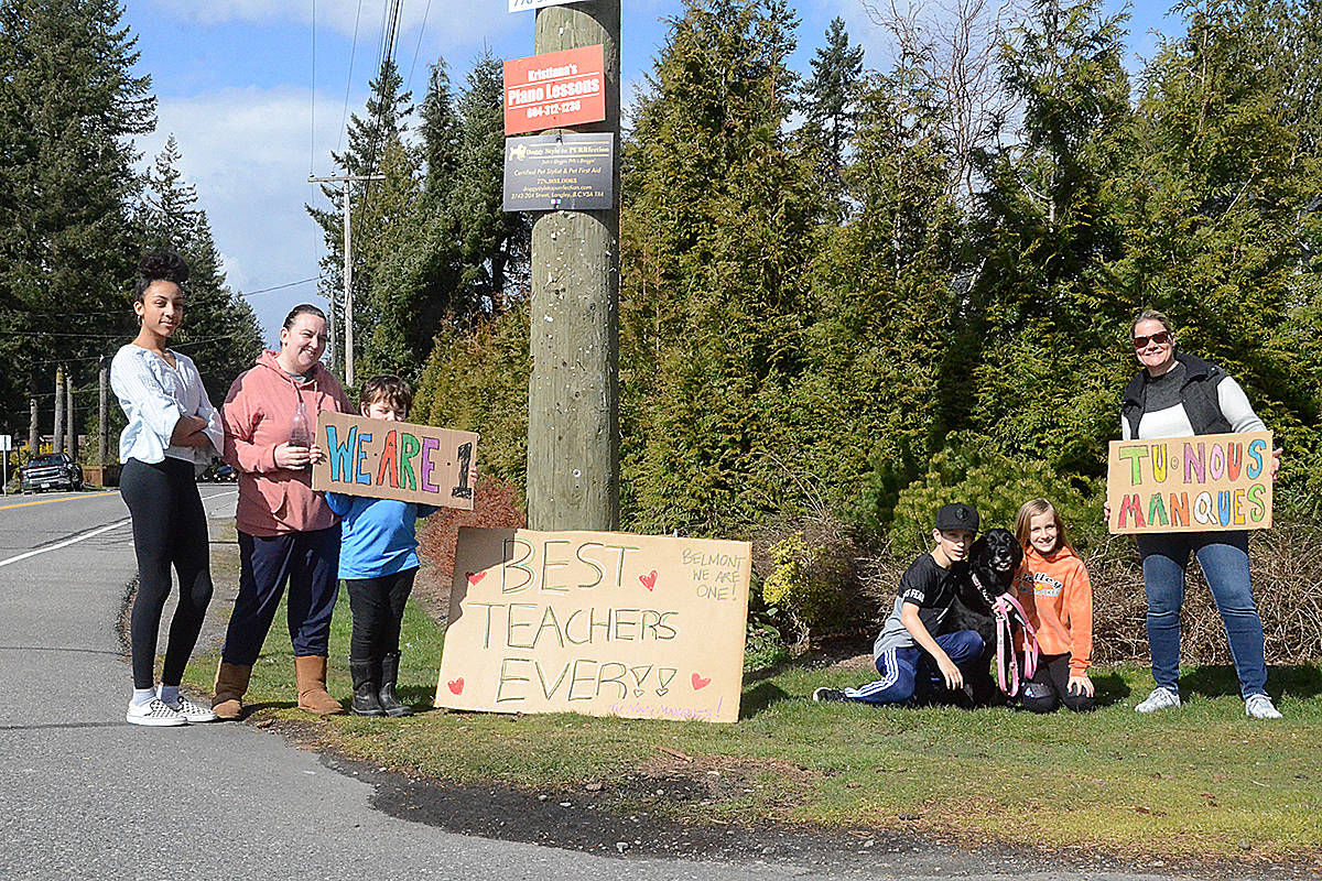 Families gathered at corners to show support. (Matthew Claxton/Langley Advance Times)