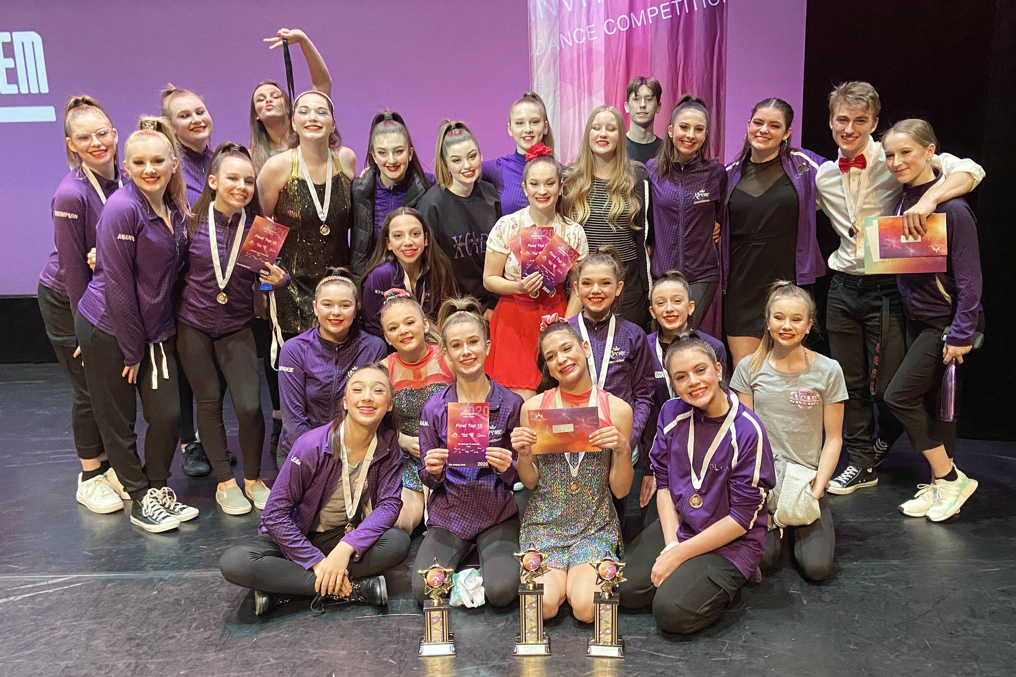 Langley Extreme Cheer and Dance competitors pose with their awards at the Peak Invitational in March in Surrey, the first, and so far only, major competition they've been able to attend. (special to Langley Advance Times