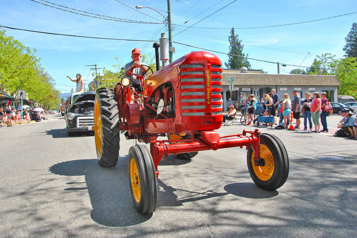 Fort Langley Lions Club May Day Parade in 2018 features old tractors among dozens of other floats. (Langley Advance Times files)