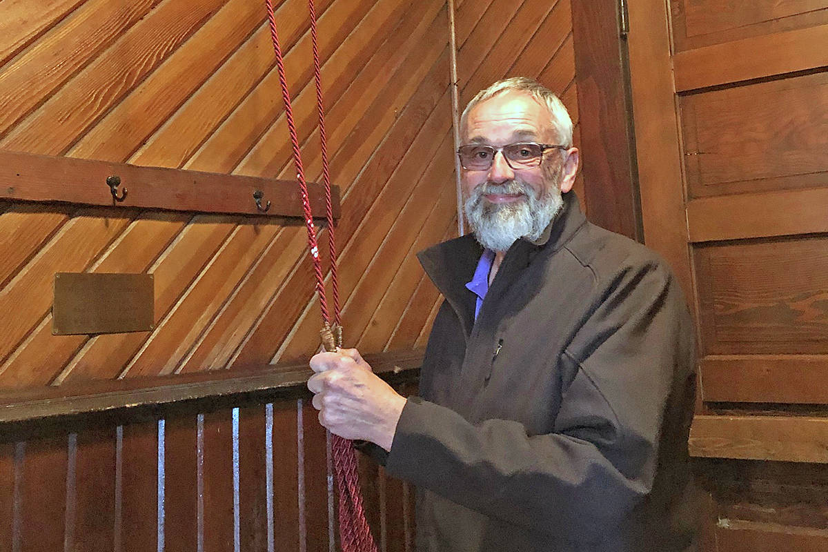 Ken Napier rings the bells at the heritage Milner Chapel to show support for first responders. (Nancy Napier/special to Langley Advance Times)