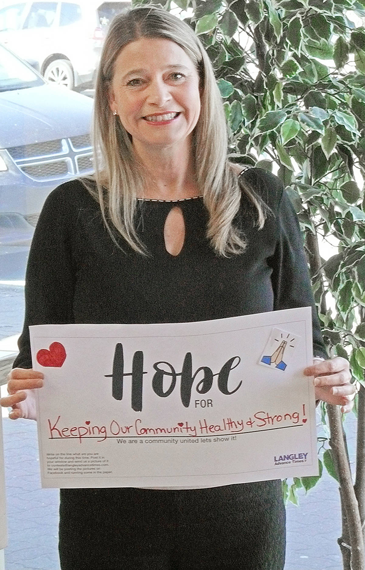 Langley Advance Times sales consultant Tammy Berry hung this sign in the front office window expressing her Hope For keeping our community healthy and strong. (Dan Ferguson/Langley Advance Times)
