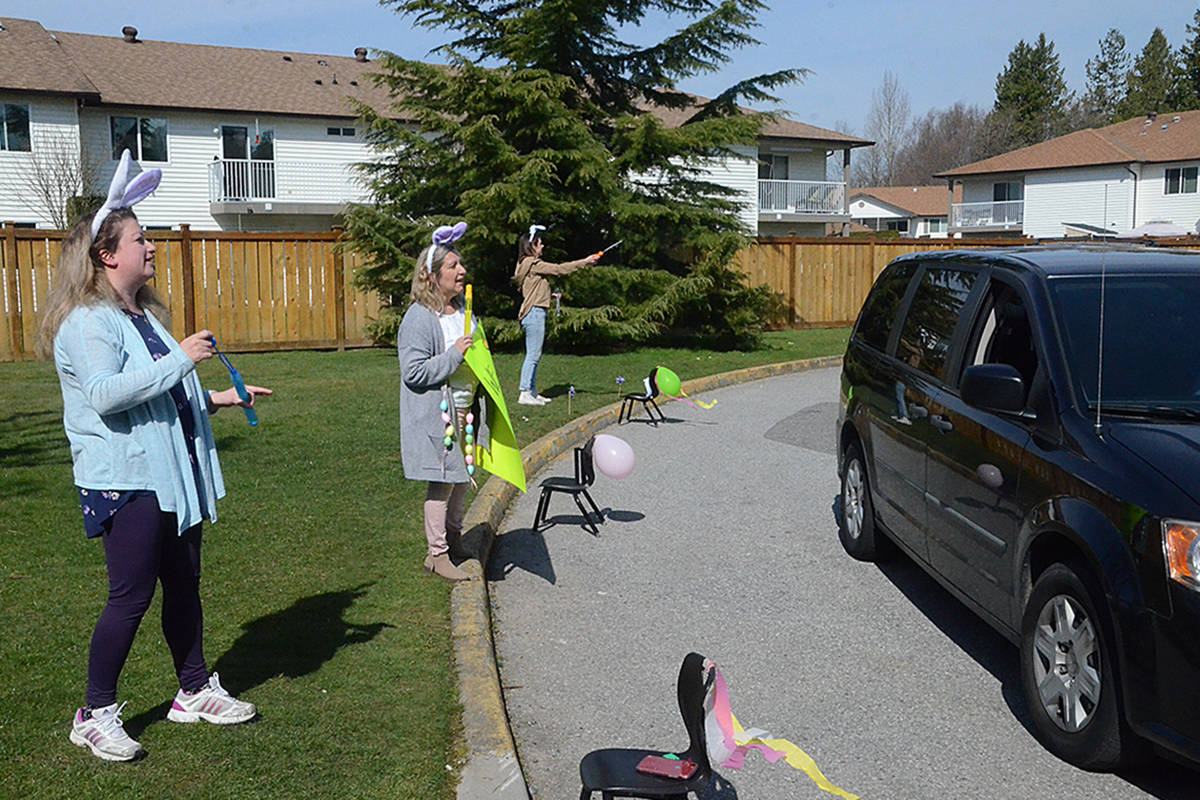Angela Vuvyer, Francine Frisk, and Kaila Olichny greeted families of Sunbeam Daycare as they stopped by the day before the Easter weekend in Langley. (Matthew Claxton/Langley Advance Times)
