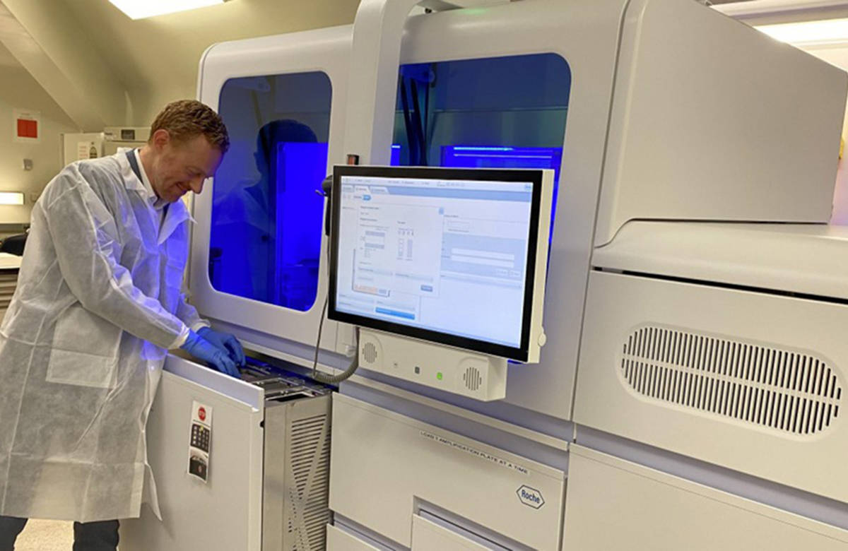 Dr. Marc Romney with the Roche cobas 6800 system at St. Paul's Hospital in Vancouver in March 2020. (Vancouver Coastal Health photo)