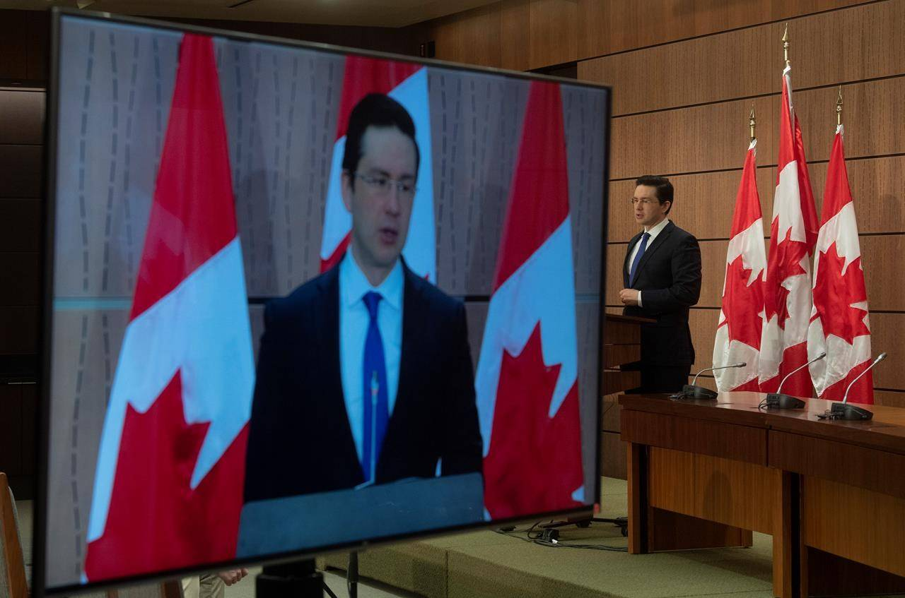Conservative MP Pierre Poilievre speaks during a news conference in Ottawa, Monday April 13, 2020. THE CANADIAN PRESS/Adrian Wyld