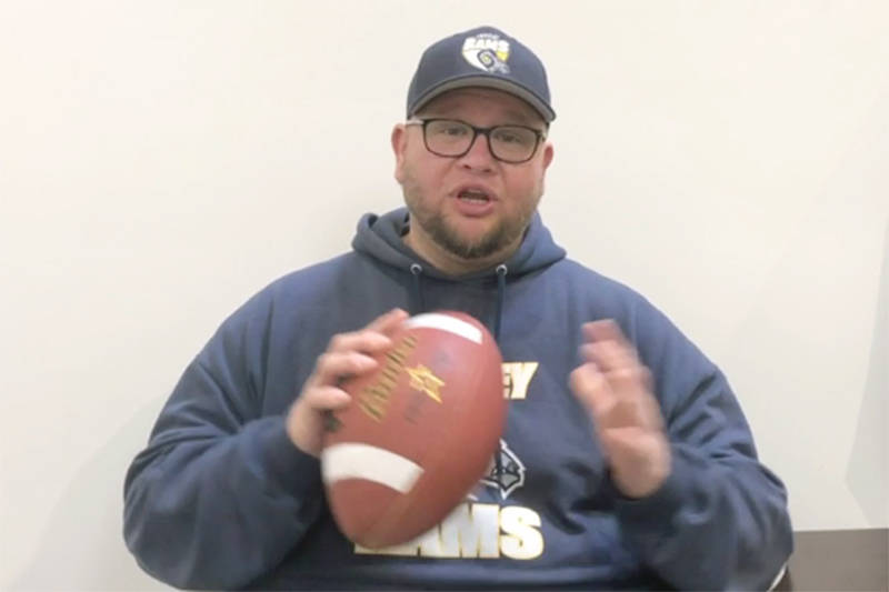 Rams head coach Howie Zaron gets things started in a whimsical training video released by the Langley football team. (Facebook image)