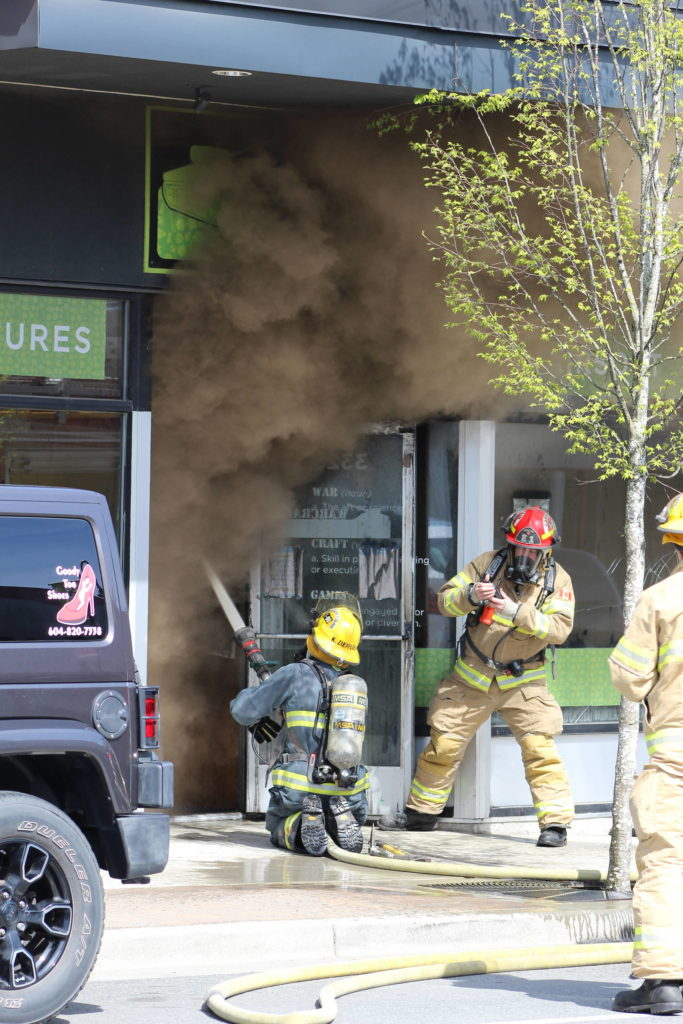 Mission Fire Rescue Service is battling a fire at Warcraft Games on First Ave. / Kevin Mills Photo