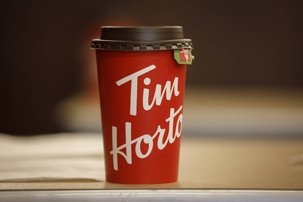 A Tim Hortons cup is seen inside a Tim Hortons restaurant in Toronto on March 6, 2020. As the COVID-19 pandemic started to hit Canada last month, Tim Hortons eyed its planned upcoming advertising and decided it didn't quite work anymore amid mass restaurant closures, wide-scale layoffs and physical distancing guidelines all that have upended life as Canadians knew it. THE CANADIAN PRESS/Cole Burston