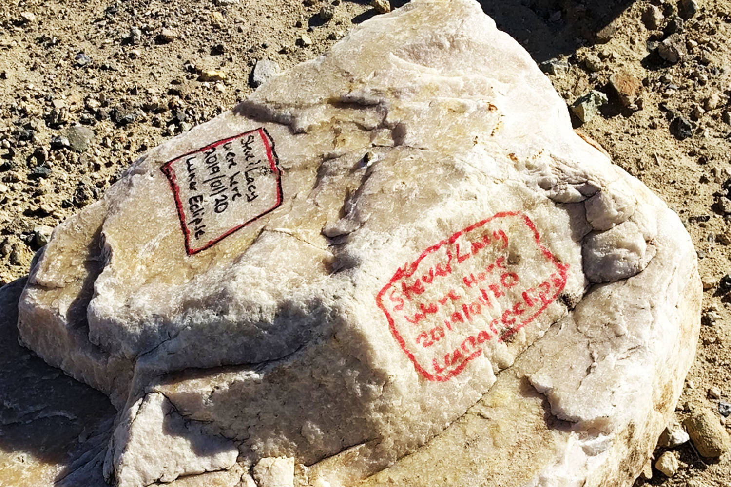 "Graffiti on two sides of a boulder in Death Valley National Park is from 2019 and 2020, marked ""Steve & Lacy"". The National Parks Service is seeking a man from Grand Forks, B.C., in connection with the graffiti. (US National Parks Service)"