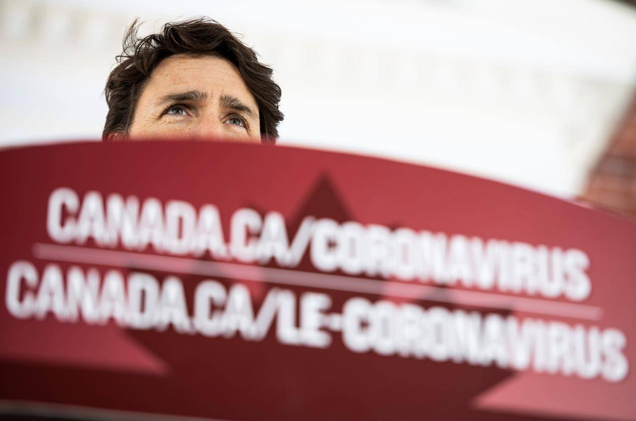Prime Minister Justin Trudeau in front of his residence at Rideau Cottage in Ottawa, on Sunday, March 22, 2020. (Justin Tang/ THE CANADIAN PRESS)