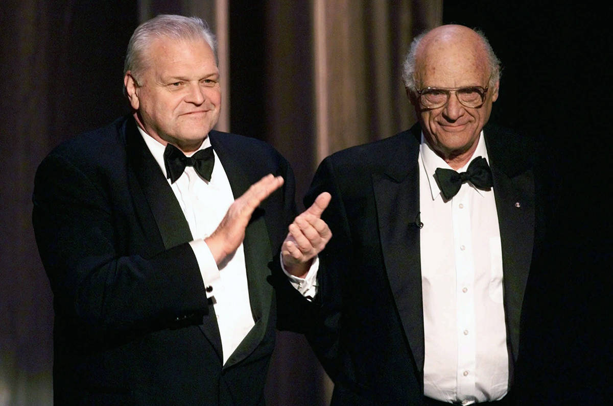 FILE - In this June 6, 1999 file photo, actor Brian Dennehy, left, applauds playwright, Arthur Miller, before awarding him the Lifetime Achievement Award at the Tony Awards in New York. Dennehy, the burly actor who started in films and later in his career won plaudits for his stage work in plays, died of natural causes on Wednesday, April 15, 2020 in New Haven, Conn. He was 81. (AP Photo/Kathy Willens, File)