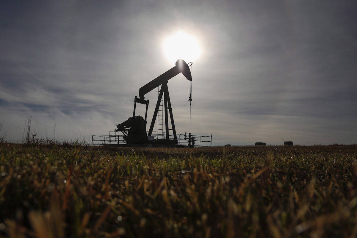 A pumpjack works at a well head on an oil and gas installation near Cremona, Alta., Saturday, Oct. 29, 2016. Alberta's Orphan Well Association is warning that the financial failure of Calgary junior producer Houston Oil and Gas Ltd. leaves more than 1,400 wells without a responsible owner. THE CANADIAN PRESS/Jeff McIntosh