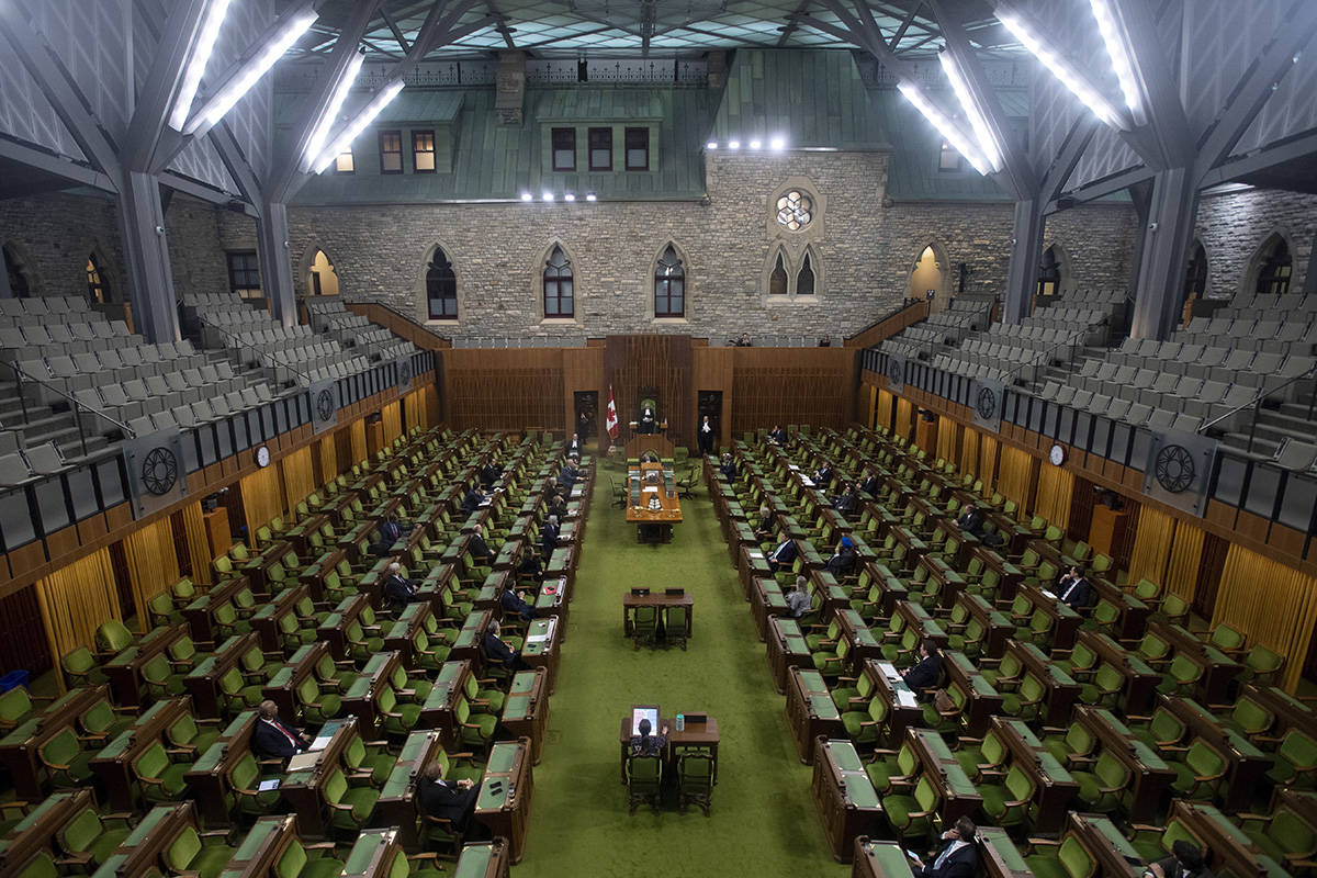 FILE – Leader of the Government in the House of Commons Pablo Rodriguez rises to ask for an extension of the sitting day in the House of Commons Parliament in the House of Commons Tuesday March 24, 2020 in Ottawa. THE CANADIAN PRESS/Adrian Wyld