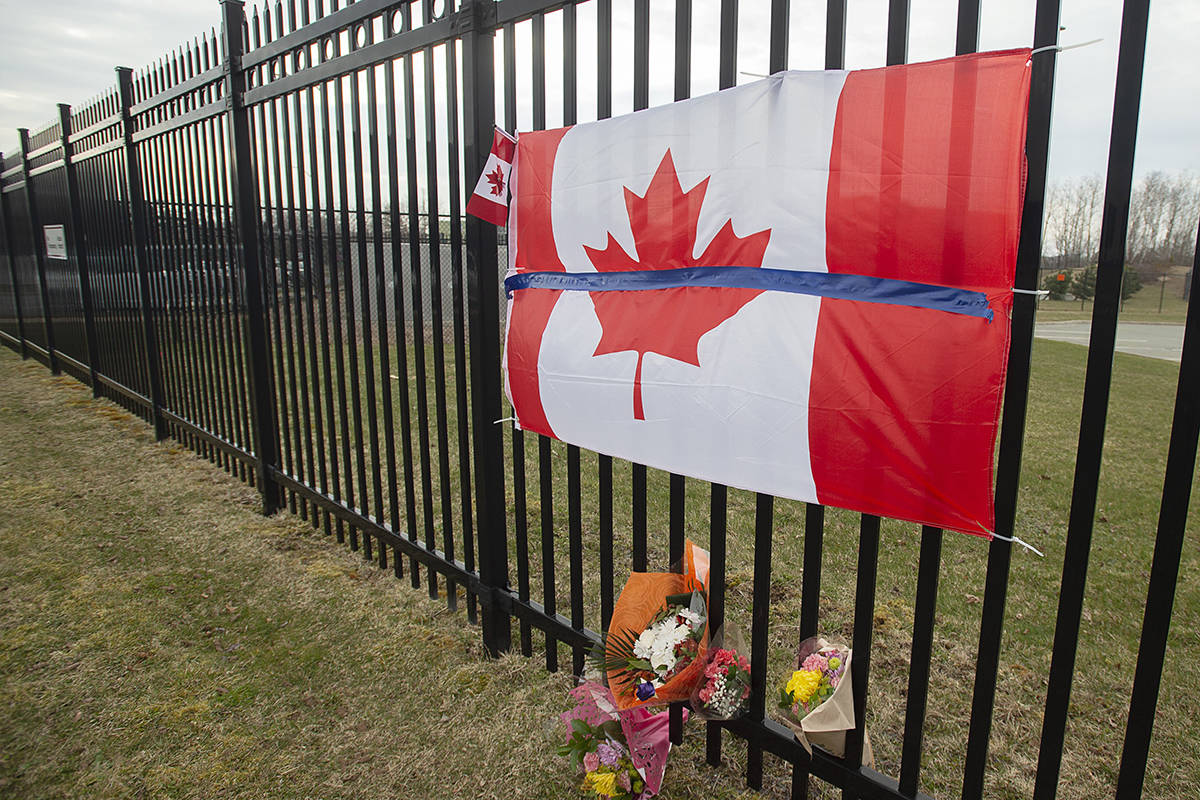 A tribute is seen at RCMP headquarters in Dartmouth, N.S. on Monday, April 20, 2020. Police say at least 17 people are dead, including RCMP Const. Heidi Stevenson, after a man, driving a restored police car, went on a murder spree in several Nova Scotia communities. Alleged killer Gabriel Wortman, 51, was shot and killed by police. THE CANADIAN PRESS/Andrew Vaughan