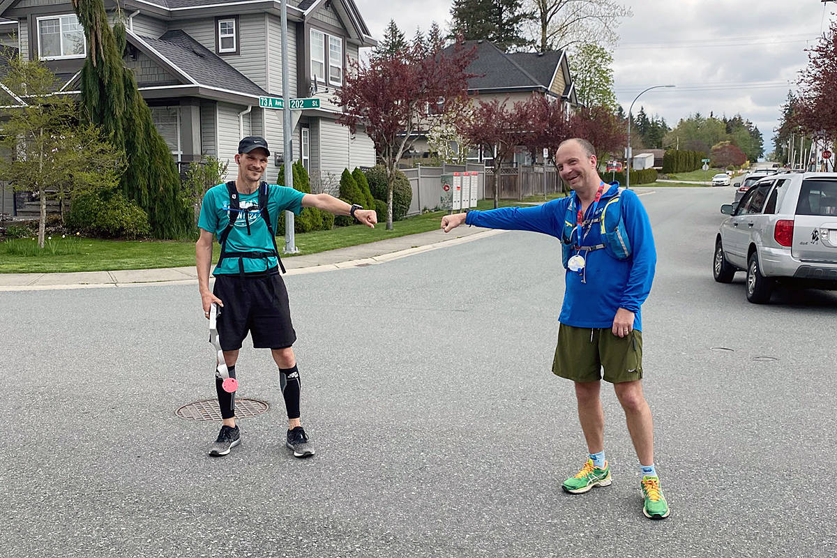 Douglas Delipper and Duncan Magnus (right) at the end of their at-home version of the Boston Marathon on Sunday April 19th in their Willoughby neighbourhood. special to Langley Advance Times)