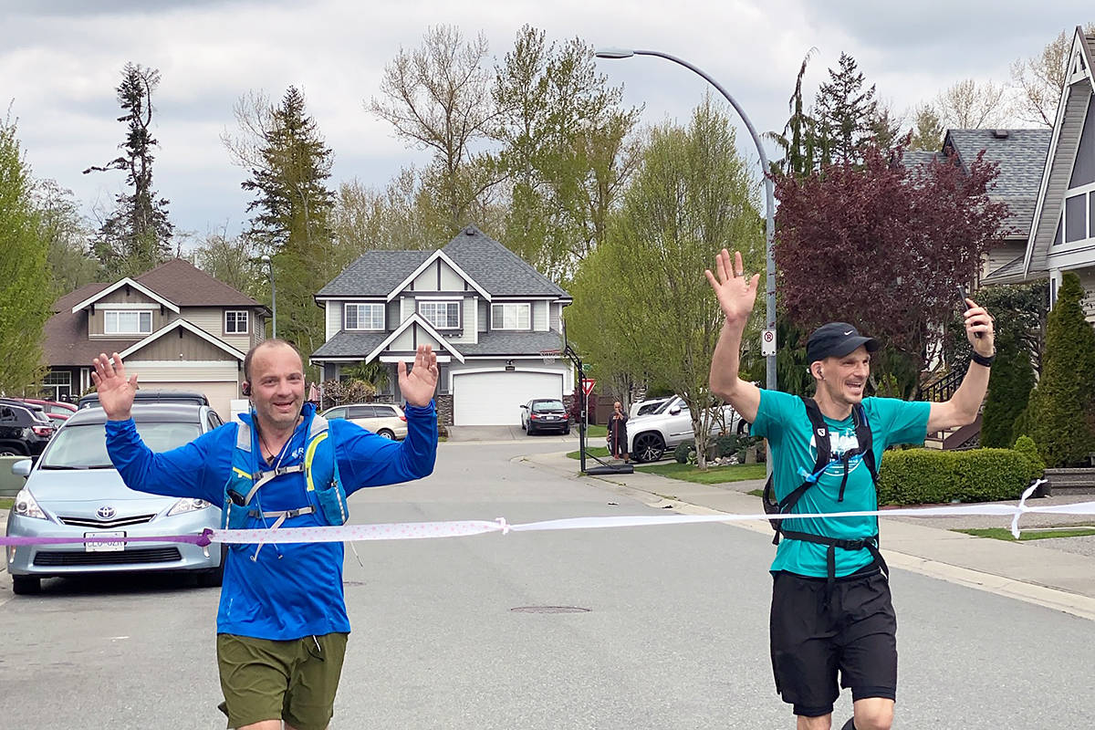 Duncan Magnus (left) and Douglas Delipper crossed the finish line at the end of their at-home version of the Boston Marathon on Sunday April 19th in their Willoughby neighbourhood. special to Langley Advance Times)