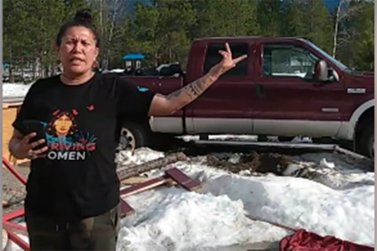 Tiny House Warriors group leader Amanda Soper stands in front of her truck that she said was stolen and rammed into one of the group's houses during an April 19 attack on the group's encampment. Facebook photo