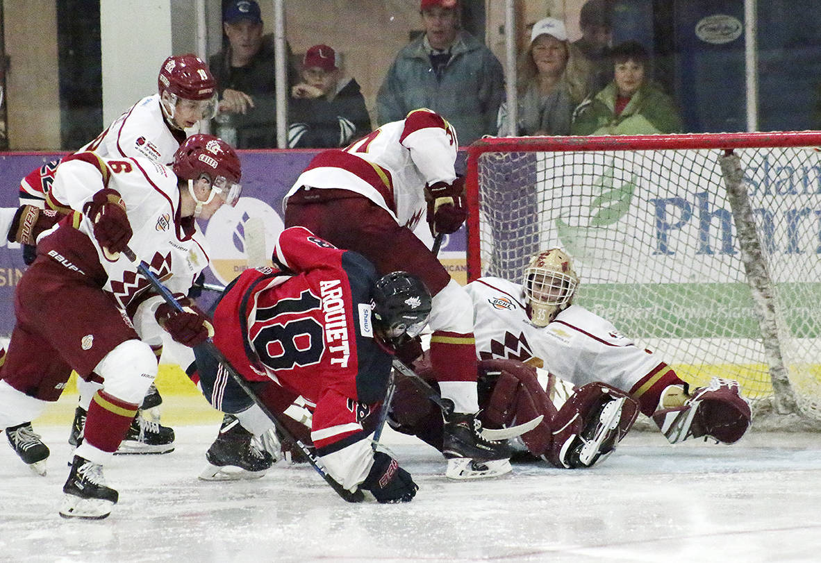 The Cowichan Valley Capitals and Chilliwack Chiefs battle in a game during the 2019-20 B.C. Hockey League season. (File photo)