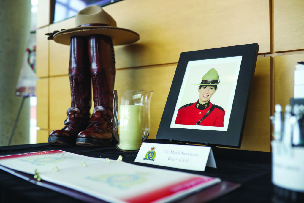 A display dedicated to Constable Heidi Stevenson at RCMP headquarters in Dartmouth, Nova Scotia, Monday, April 20, 2020. Investigators say a killer's use of a mock police cruiser and an RCMP uniform almost identical to the real thing helped him escape detection as he travelled between 16 crime scenes in a rampage that has left at least 19 dead in Nova Scotia. THE CANADIAN PRESS/Riley Smith