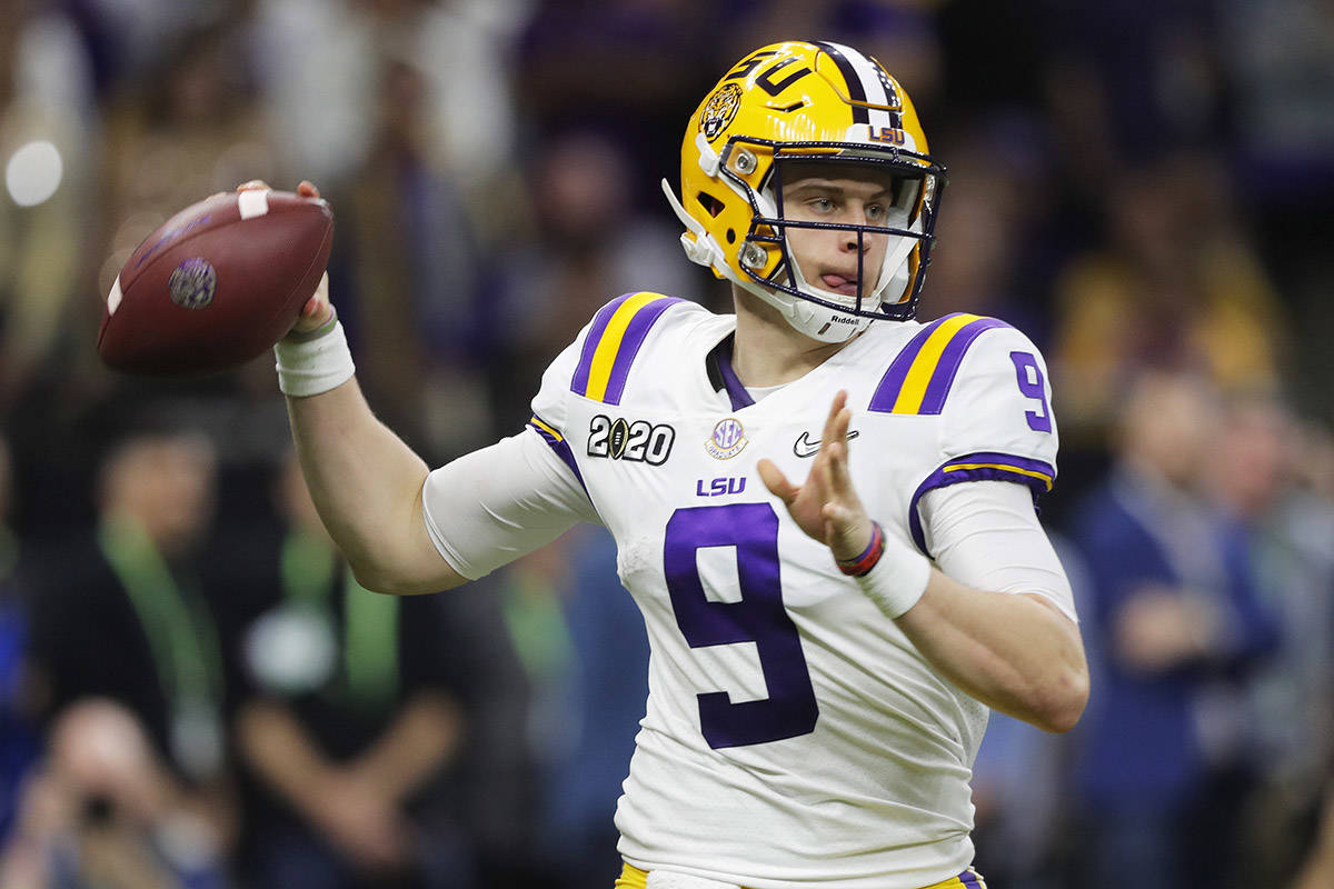 In this Jan. 13, 2020, file photo, LSU quarterback Joe Burrow throws a pass against Clemson during the second half of the NCAA College Football Playoff national championship game in New Orleans. The Cincinnati Bengals chose Burrow with the first pick in the NFL draft Thursday, April. 23, 2020. (AP Photo/Gerald Herbert, File)