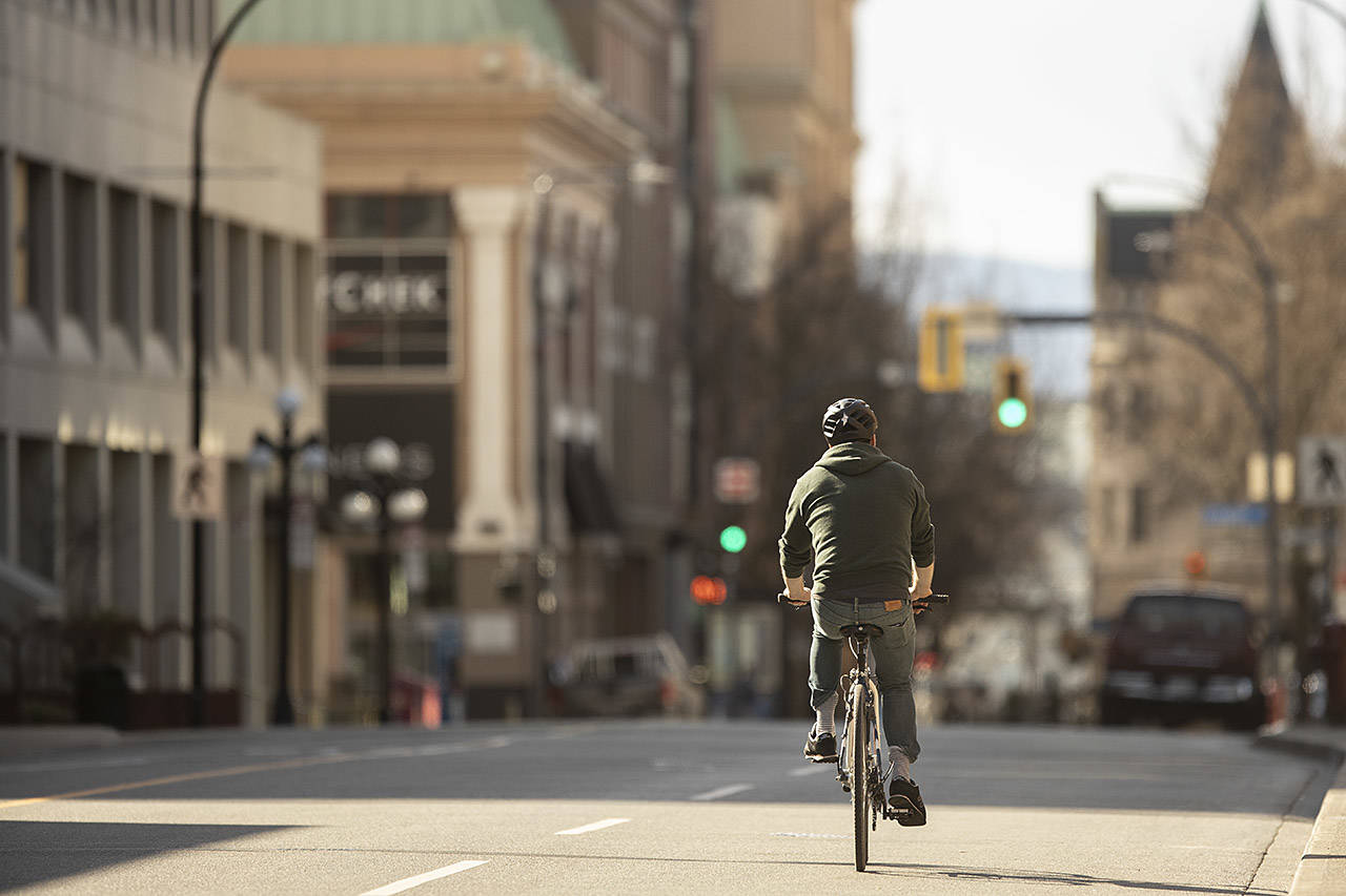 In this photo taken on March 25, 2020, streets of downtown Victoria were quieter than usual in the wake of physical isolation mandates from the provincial and federal governments. (Arnold Lim / Black Press)