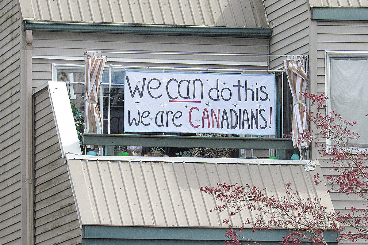 This handmade banner hangs on the deck of a 204th Street complex, offering assurances that #WereInThisTogether. (Special to Langley Advance Times)