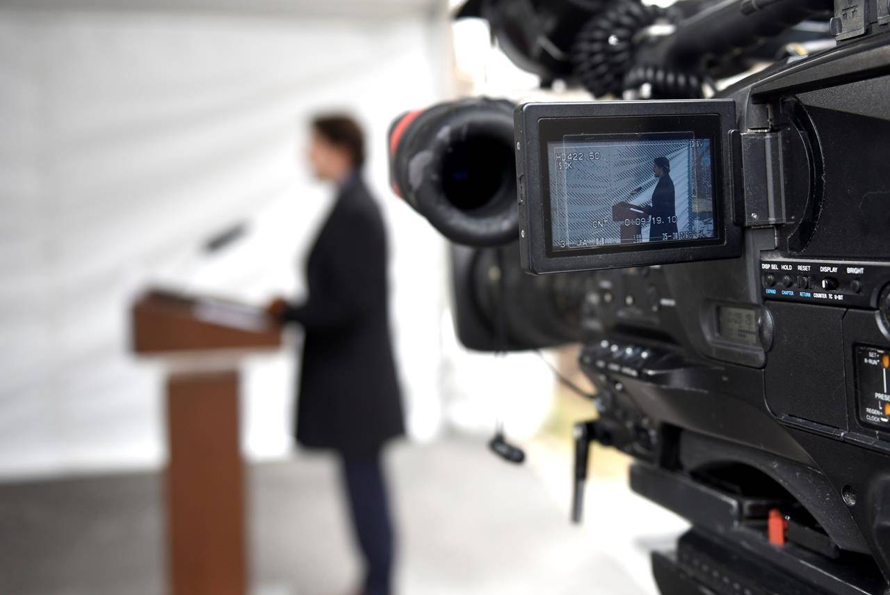 Prime Minister Justin Trudeau is seen on the screen of a broadcast camera as he speaks during his daily press conference on the COVID-19 pandemic, outside his residence at Rideau Cottage in Ottawa, on Friday, April 24, 2020. THE CANADIAN PRESS/Justin Tang