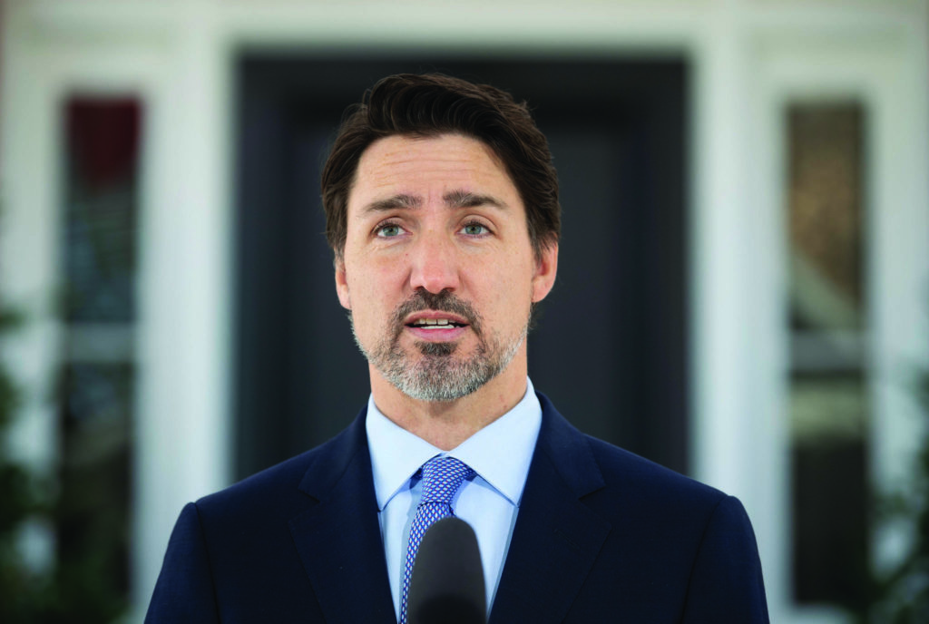 Prime Minister Justin Trudeau speak to the media during a news conference about the COVID-19 virus outside Rideau Cottage in Ottawa, Wednesday March 18, 2020. THE CANADIAN PRESS/Adrian Wyld