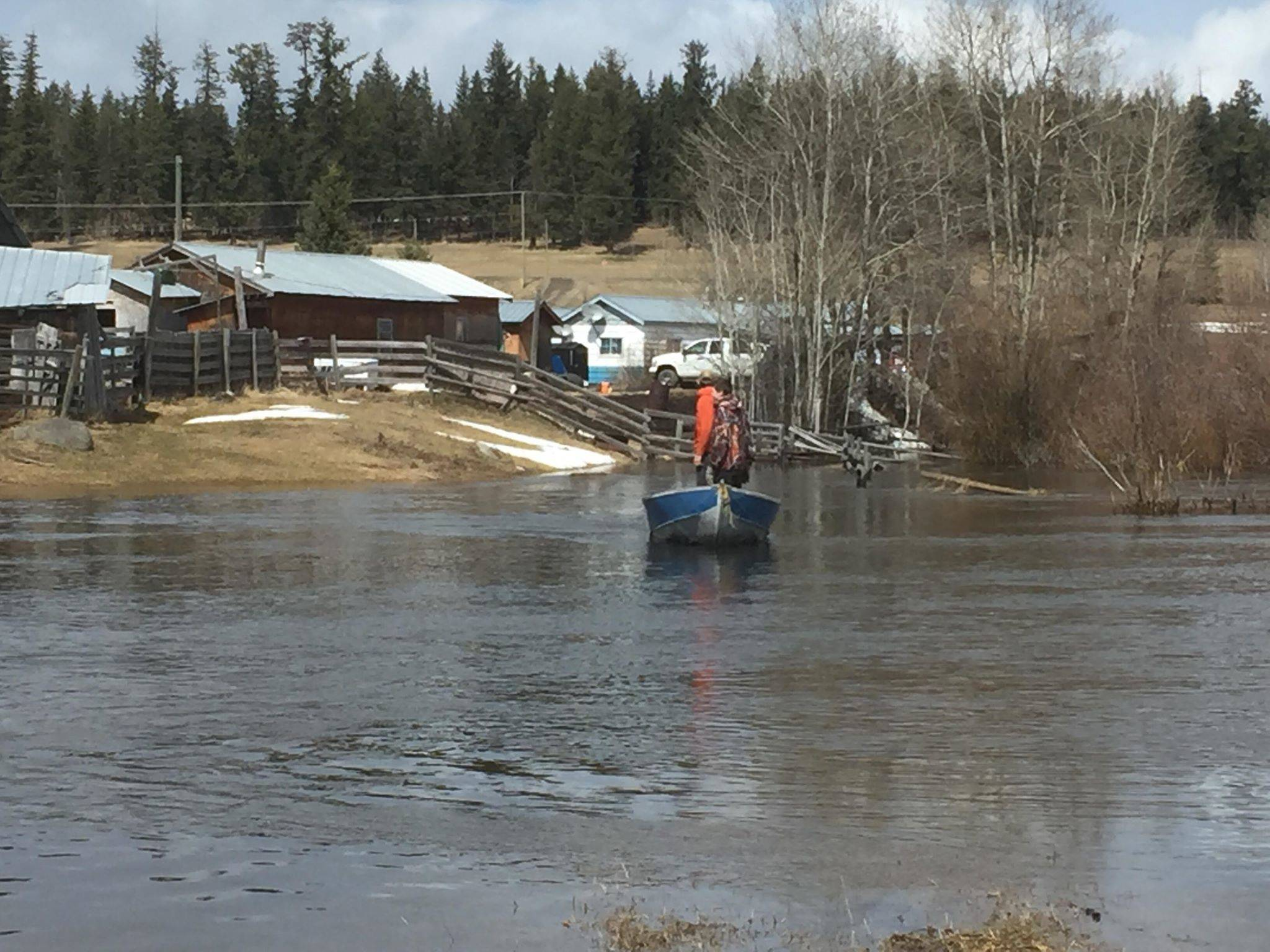 Rose Lake resident Charlotte Morrow has been using her boat to ferry local residents cut off by flooding. Here the boat is in a flooded field Friday. (Charlotte Morrow photo)
