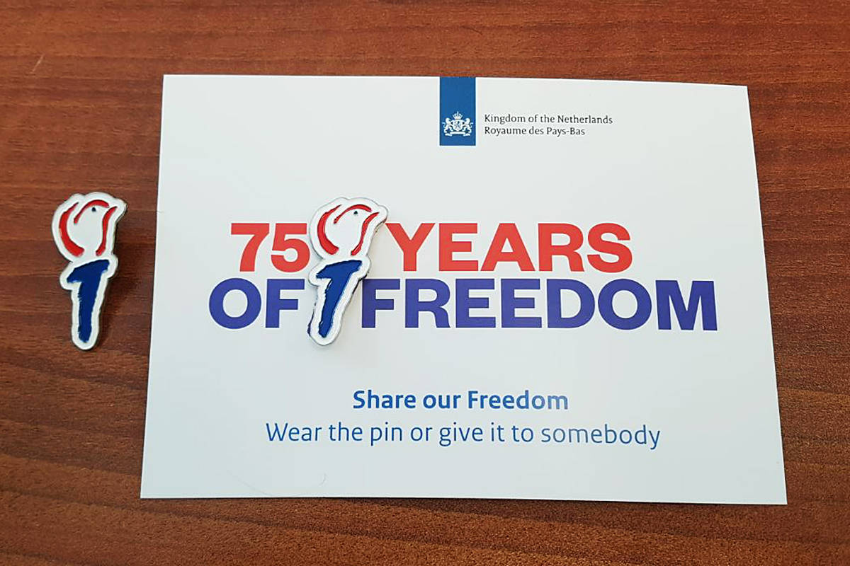 Special pins to remember Canada's liberation of the Netherlands are being distributed by Langley-Aldergrove MP Tako Van Popta (special to the Langley Advance Times)