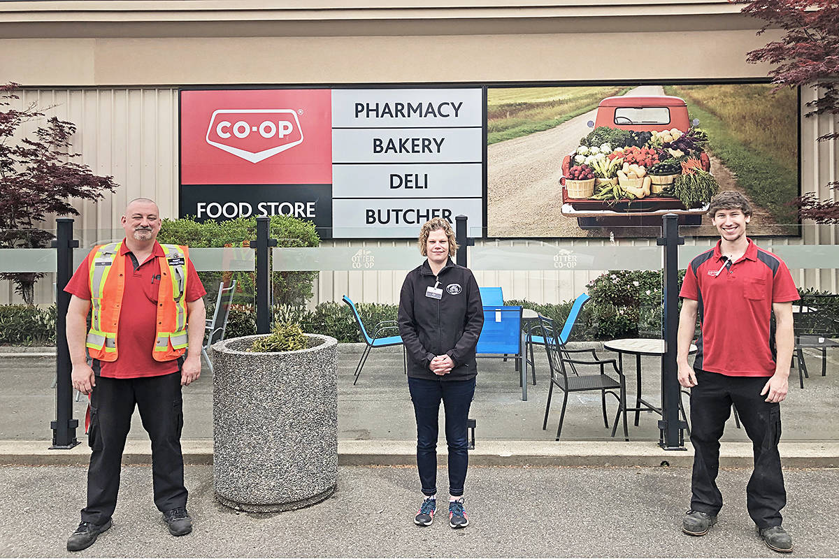 Otter Co-op staffers Darcy Lueks, Dana Munro and Brandon Kosciuk demonstrated social distancing. (special to Langley Advance Times)