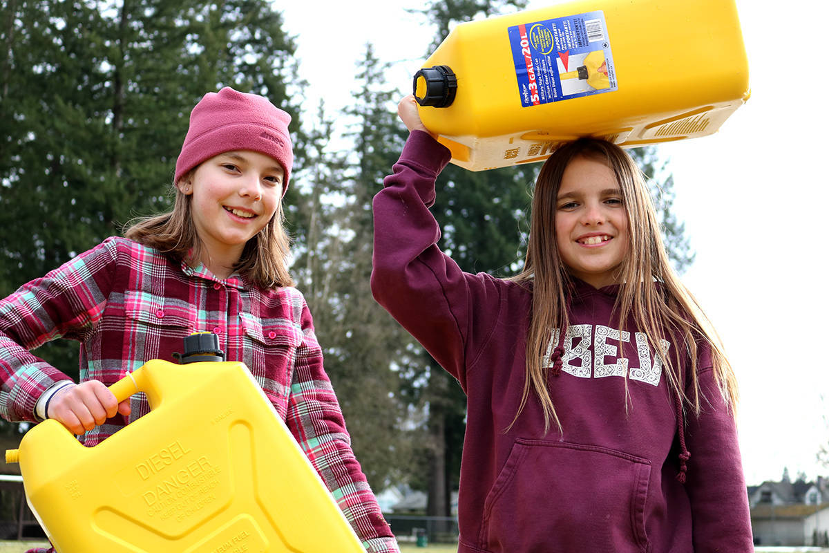 Langley Fine Arts School students carried jerrycans full of water. (Langley Advance Times files)