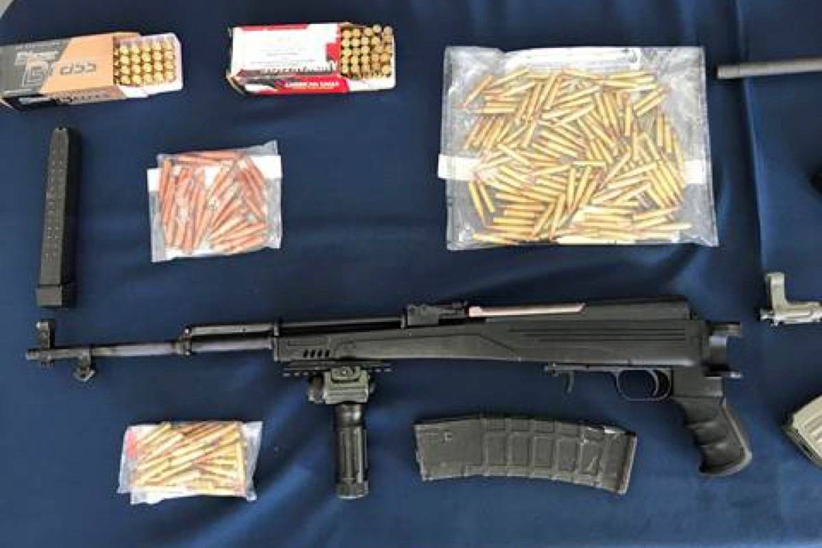 Weapons and ammunition seized from the Langley property in November 2017. (Vancouver Police)