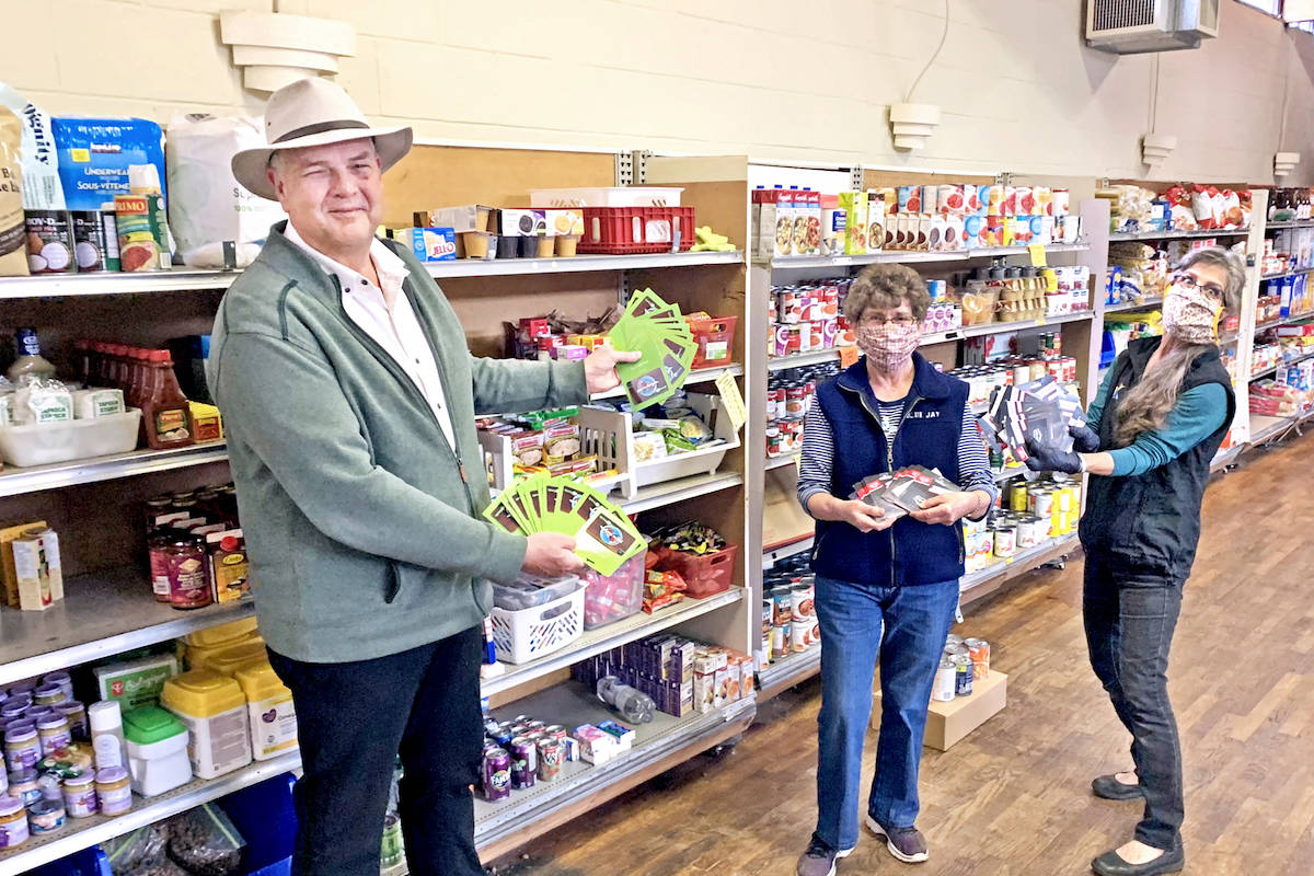 Rotarian Larry McGuinness gave the first $1,500 – of a total $2,500 in grocery gift cards – to the Aldergrove Food Bank for local families on April 21. (Pauline Buck/Special to the Aldergrove Star)