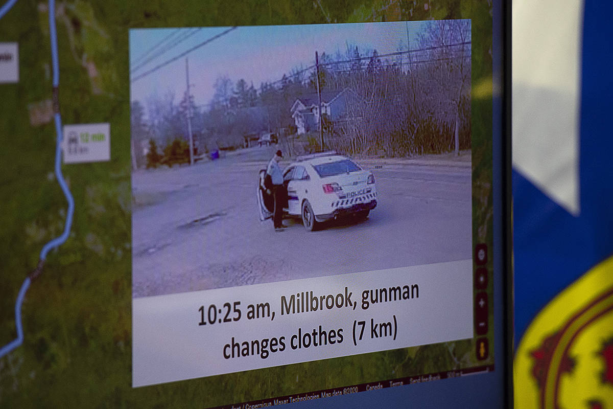 This photo showing the gunman changing clothes beside a replica RCMP vehicle is displayed at a media briefing RCMP headquarters in Dartmouth, N.S., Tuesday, April 28, 2020. The Nova Scotia RCMP say the replica police car driven by a gunman who killed 22 people this month was obtained in the fall of 2019. THE CANADIAN PRESS/Andrew Vaughan